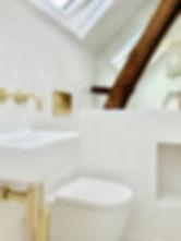 stylish-shower-room-polished brass taps.jpeg