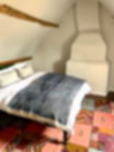 stylish-attic-bedroom-chimney.jpg