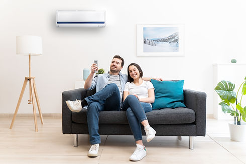 Happy couple freshen up using air condit