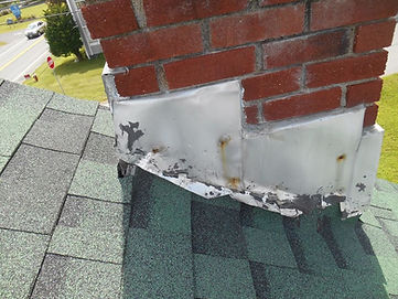 This picture shows a damaged chimney flashing