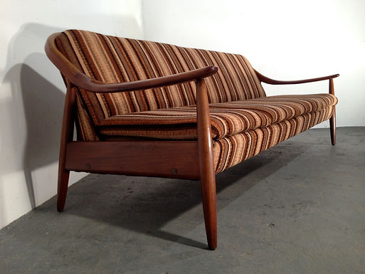 Vintage Greaves and Thomas sofabed in a sculptured afromosia teak frame