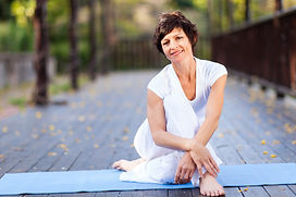 fit middle aged woman relaxing after wor