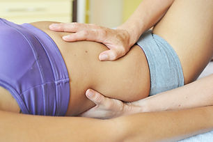 Young woman is getting osteopathy treatm