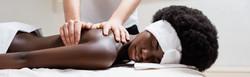 Masseur massaging african american woman