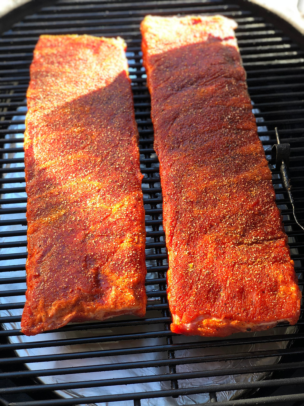 Ribs seasoned and on the Primo