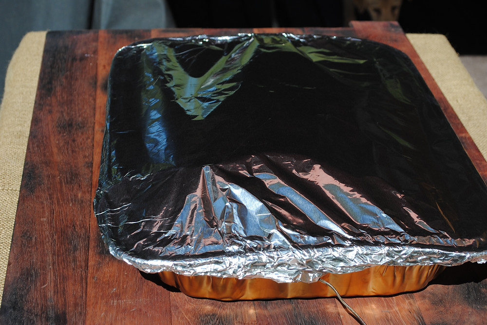 Covered brisket with two sheets of tin foil and place back on the grill.