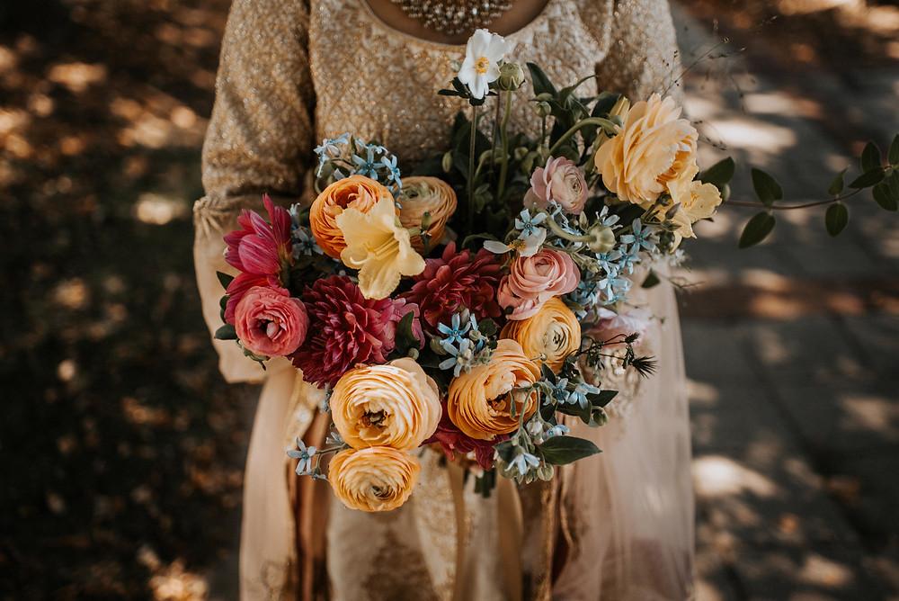 Casa Delirio bouquet with dahlias and ranunculus. Photo by Wildjune