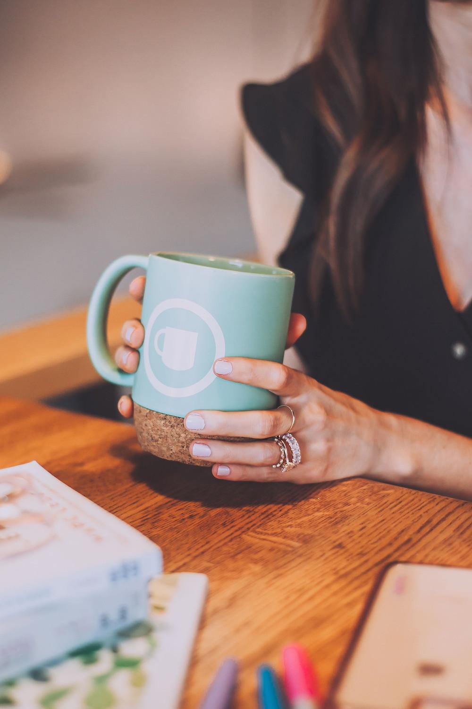 women's hands on a coffee mug
