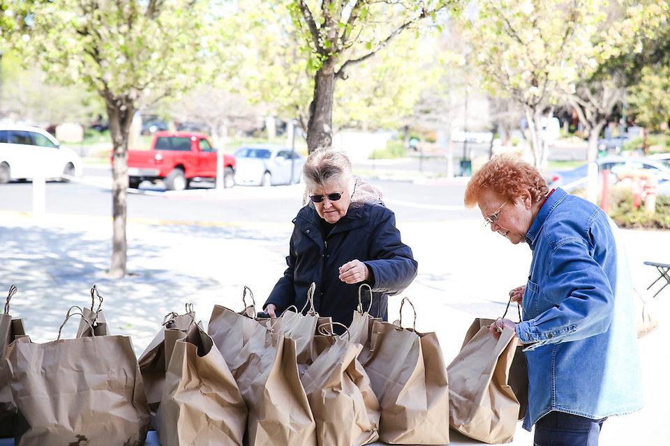 Family Meal Seniors Grabbing Bags .jpg