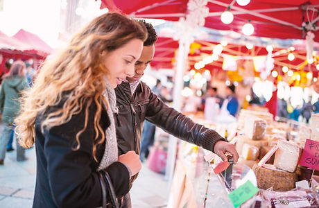 Couple Looking at Cheese at Market