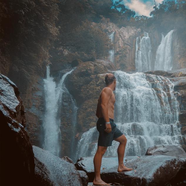 shirtless dude waterfall.png