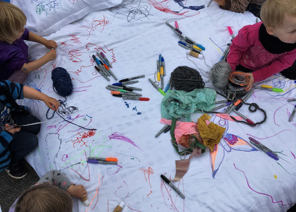 Collaboratively drawing, designing and sewing on the bed