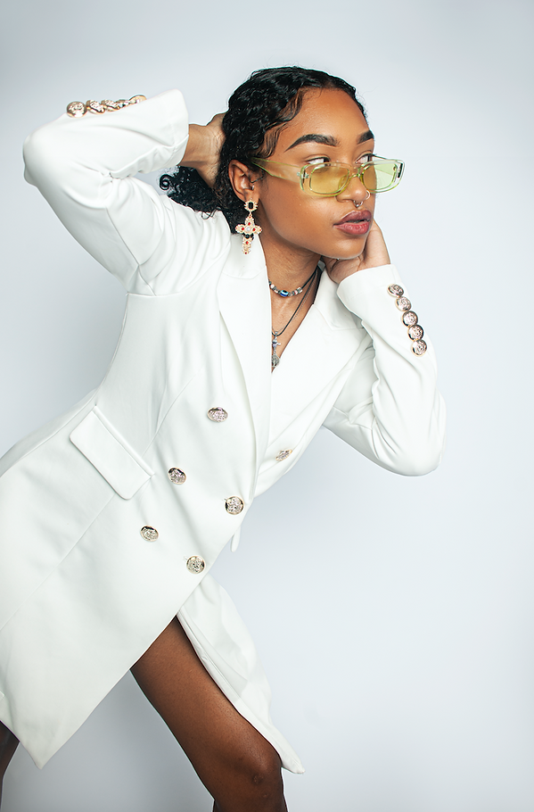 Model wearing white blazer photographed by Emily Light