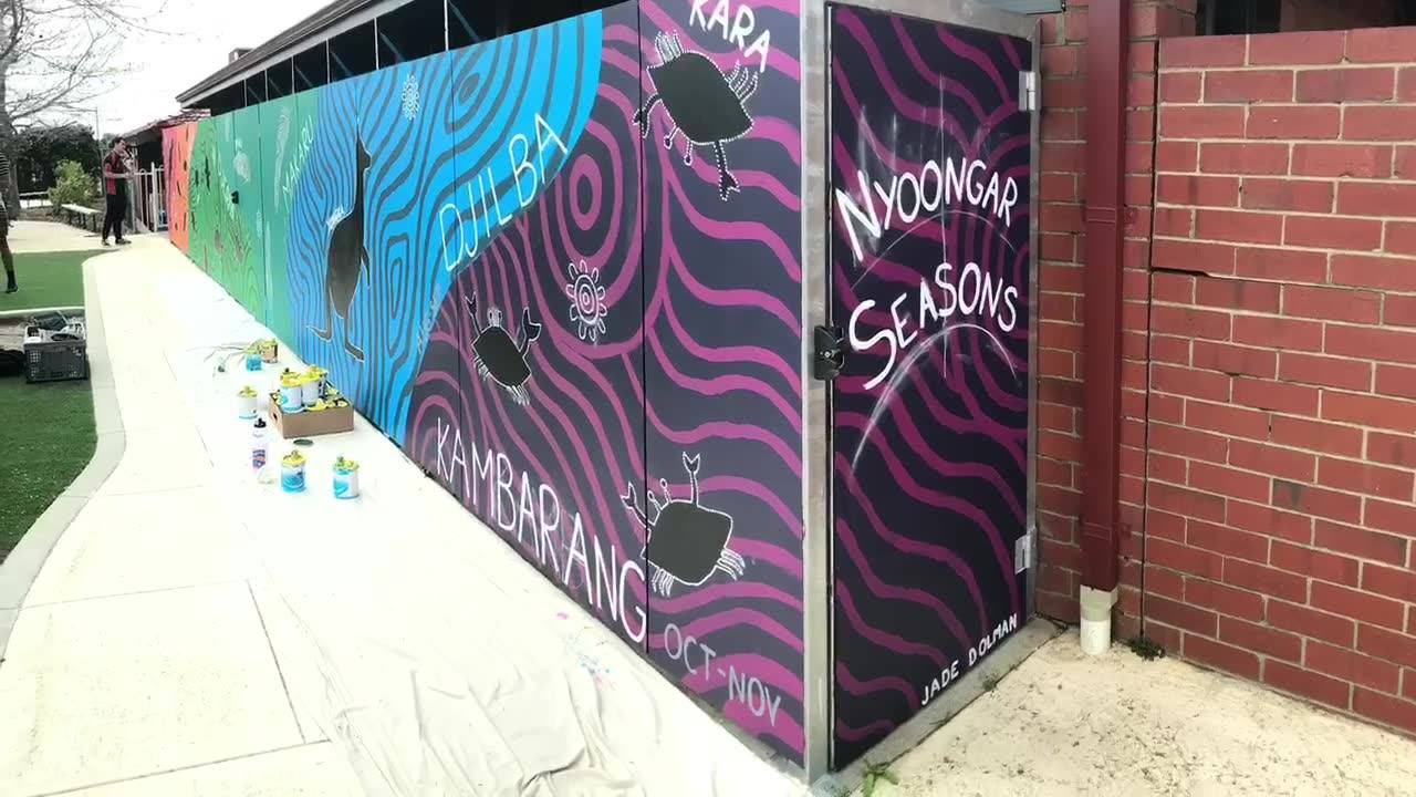 Nyoongar Seasons Mural at St Kieran Catholic Primary School. A lot of hands big and small helped add colour to this 8 meter wall.  www.jdpenangke.com