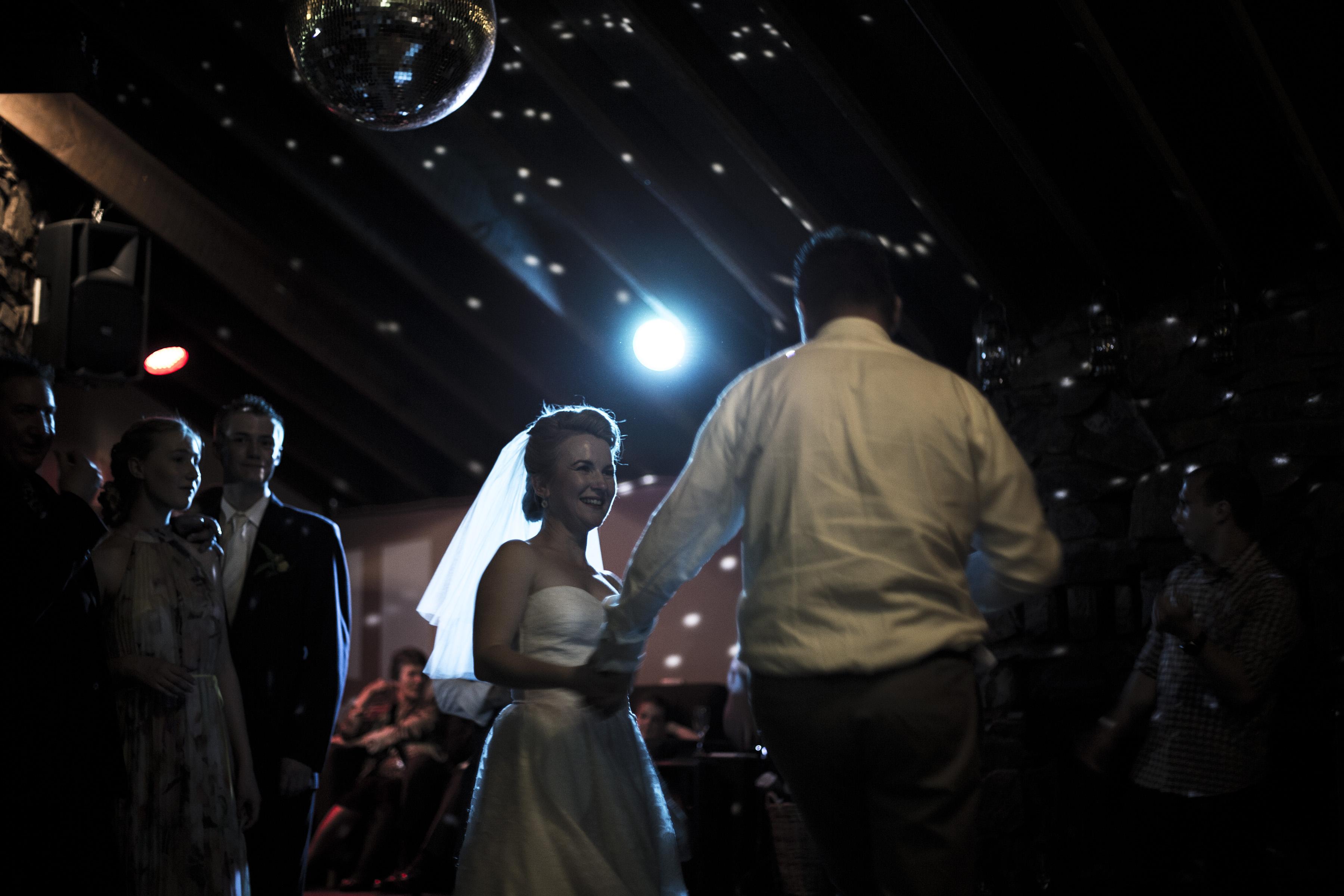 Happy dancefloor bride