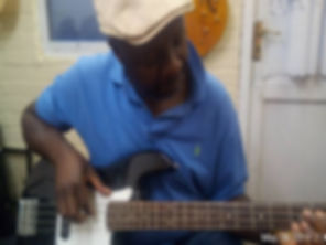 Stephen concentrating hard on his bass guitar learnig a new song during his weekly guitar lesson.