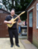 Me playing the guitar using a strap
