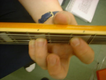 Having you fingers in the correct positon is realy important to getting a good tone and being able to play the chords cleanly. This picture shows me holding a chord on the guitar neck in the correct maner.
