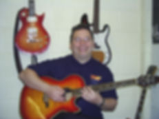 A photograph of me giving a lesson in the guitar studio in Maidstone