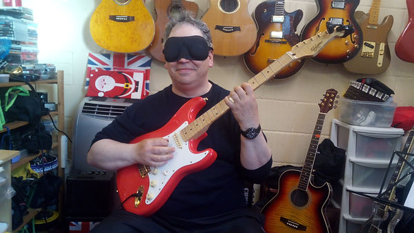 Practicing the guitar wearing a mask is the best way to improve. It improves your muscle memory and you will soon find yourself playing with much more confidence.