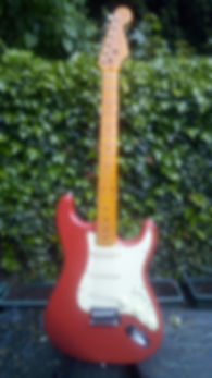 "Beautiful looking stratocaster electric guitar for sales for students of ""Guitar Lessons Music"". Maple neck and red body, the origonal colours of the stratocaster."