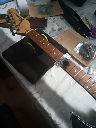 cleaning the fretboard of my guitar