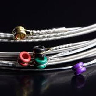 Different types of guitar strings that can be used on acoustic and electric guitars.