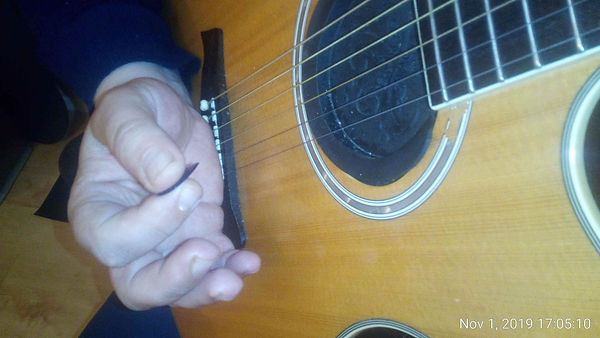 How to use the palm muting method on your guitar.