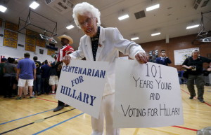 Supporter Jerry Emmett holds signs before a campaign rally by Democratic U.S. presidential candidate Hillary Clinton at Carl Hayden Community High School in Phoenix, Arizona March 21, 2016. REUTERS/Mario Anzuoni      TPX IMAGES OF THE DAY