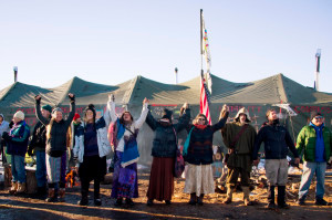 Activists celebrate at Oceti Sakowin Camp on the edge of the Standing Rock Sioux Reservation on December 4, 2016 outside Cannon Ball, North Dakota.  The Army Corps of Engineers told Standing Rock Sioux Chairman Archambault Sunday that the current route for the Dakota Access pipeline will be denied. / AFP / JIM WATSON        (Photo credit should read JIM WATSON/AFP/Getty Images)