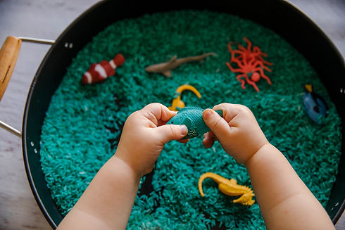Close up of toddler hands playing in blu