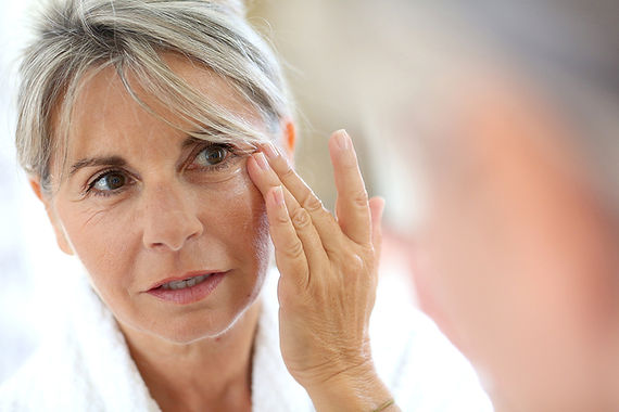 woman inspecting eye wrinkles, holiday ready with botox, holidays and Botox, look better for the holidays, how does botox work, botox before holidays