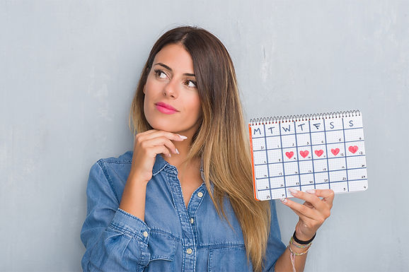 woman with calendar, lip flip FAQs, what is a lip flip, about the lip flip, lip flip frequently asked questions, lip flip vs lip filler, how does a lip flip work
