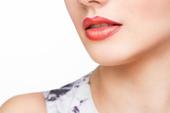 closeup of woman's shoulder, lip flip FAQs, what is a lip flip, about the lip flip, lip flip frequently asked questions, lip flip vs lip filler, how does a lip flip work