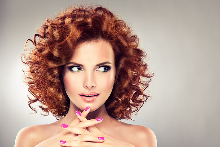 woman with red curly hair, Hairstyle Mistakes That Age You, hairstyles that make you look older, hair mistakes that age you, hair mistakes that make you look older