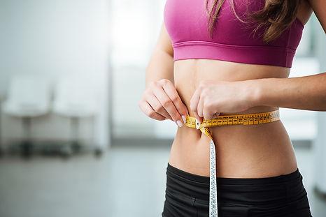 Best-Fat-Burning-Recipes-Woman-Measuring