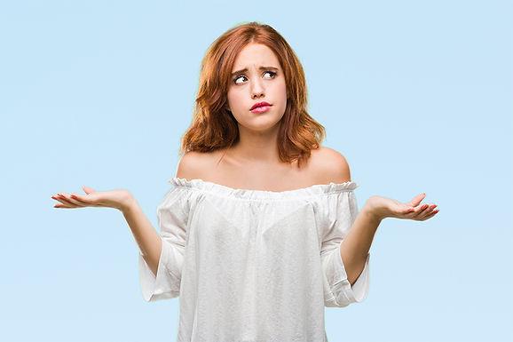 woman wondering, get rid of deep acne scars, remove acne scars, remove acne discoloration, pitted acne skin fix