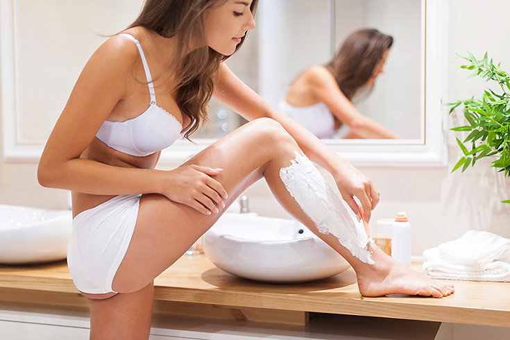 FAQs About Laser Hair Removal Woman Shaving Legs, laser hair removal FAQs, about laser hair removal, how does laser hair removal work, laser hair removal guide