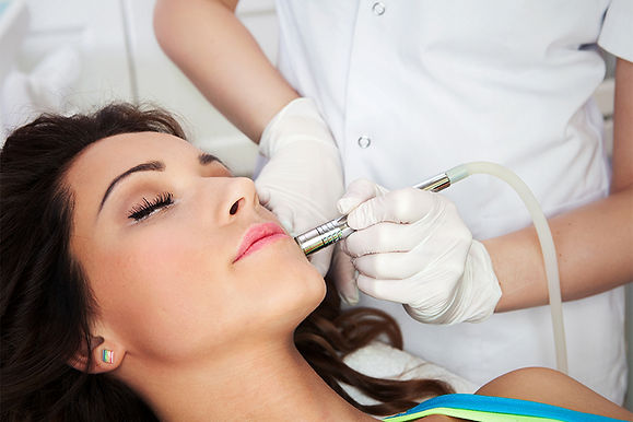 woman getting laser treatment, get rid of deep acne scars, remove acne scars, remove acne discoloration, pitted acne skin fix