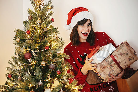 woman with christmas presents, holiday ready with botox, holidays and Botox, look better for the holidays, how does botox work, botox before holidays