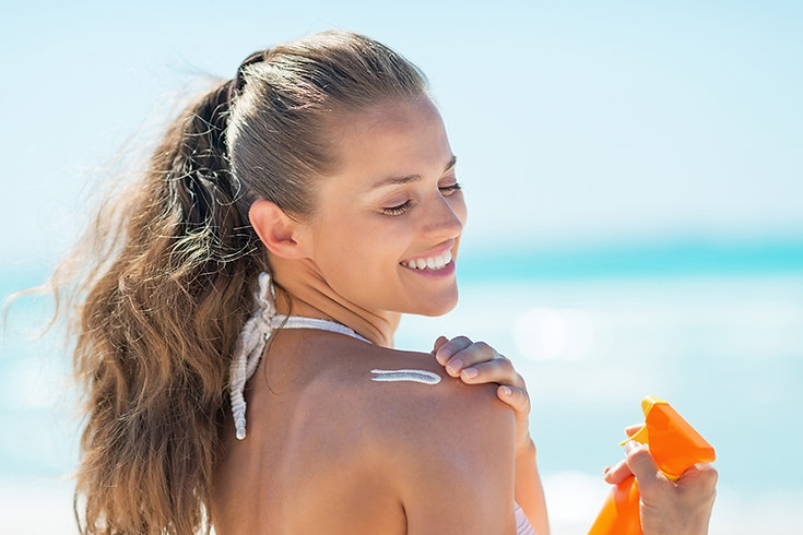 chest rejuvenation, chest microneedling treatment, shoulder skin treatment, neckline skin treatment, woman applying sunscreen