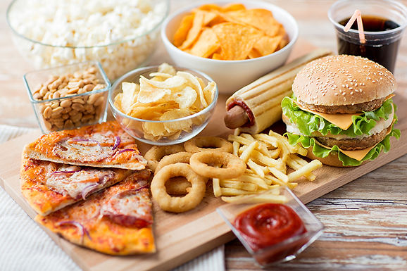 unhealthy food platter, things that are aging you, how you get wrinkles, things making you look older, habits that age you, causes of aging skin