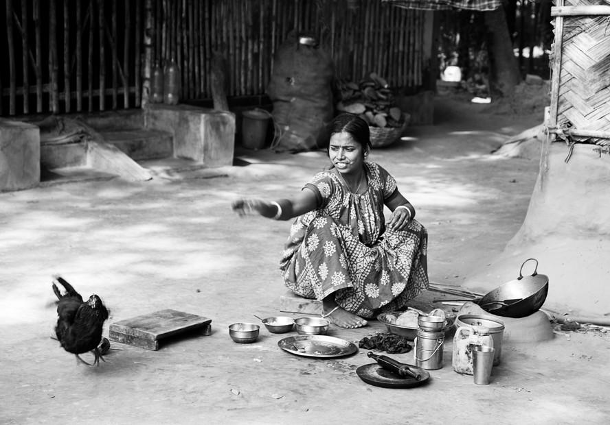 Woman Shooing Chicken Away