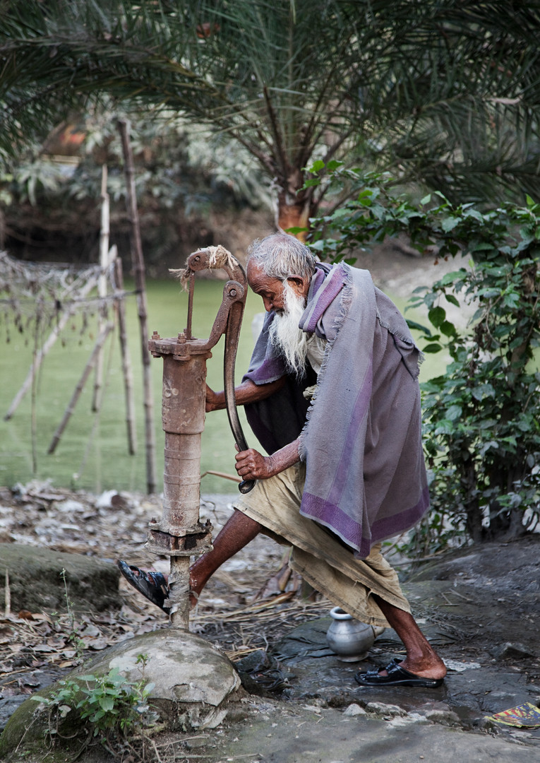 Old Farmer Washing Feet