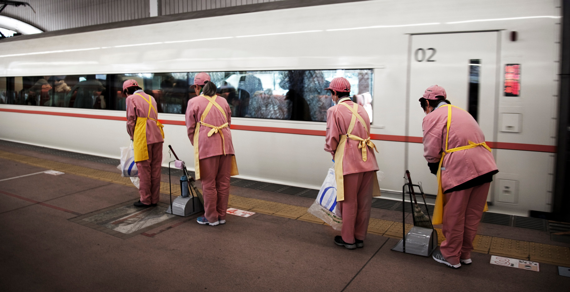 Cleaners Bow to Approaching Train