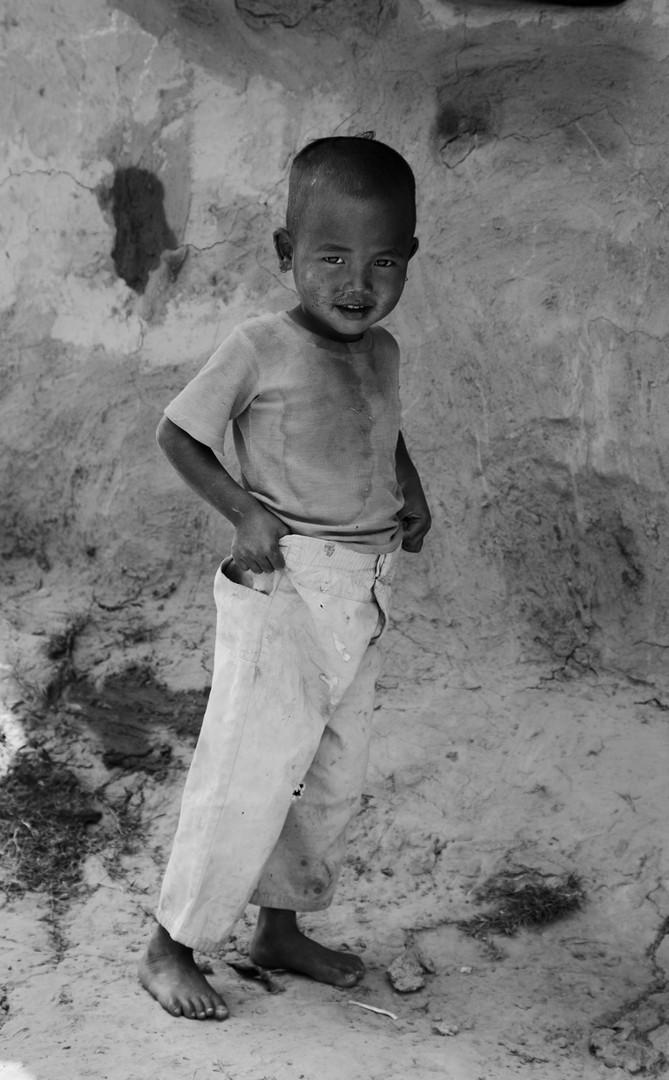 Little Boy Holding Trousers