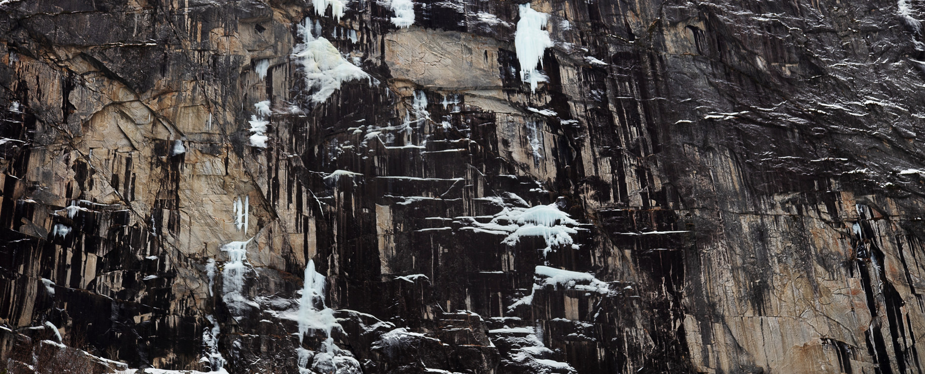 Snow Splattered Rock Face