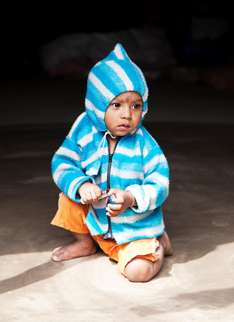 Boy in Blue Striped Hoodie