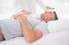 Therapist working with man in medical of