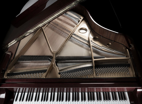 Why is a grand piano better than an upright for the serious pianist?